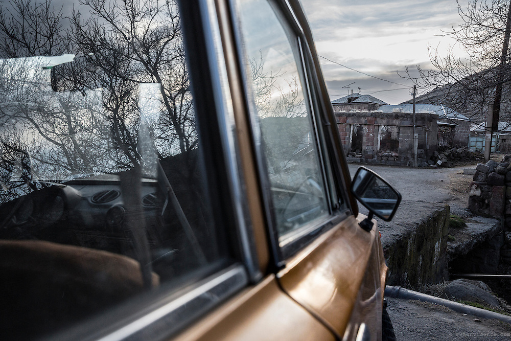 Ruins and reflections seen from the window of an old soviet Lada. Armenia