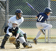 New WIndsor's Michael DeVito leaps to avoid a pitch as Minisink Valley catcher Nick O'Reilly reaches for the ball during a District 19 Little League minor boys' baseball all-star game at the Town of Wallkill on Thursday, July 16, 2009.