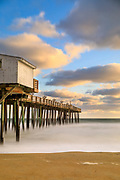 Long morning exposure of the beach and Kitty Hawk Fishing Pier, on the Outer Banks of NC.