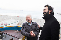 """CETARA, ITALY - 10 March 2014: Daniele De Michele (right) interviews fisherman Giuseppe """"Fragolino"""" on the beach of Cetara, Italy, on March 10th 2014.<br /> <br /> Daniele De Michele, aka Donpasta, is a DJ-economist with a passion for gastronomy who tries to combine his passions and knowledge into """"Food Sound System, political manual for musical gastronomy""""."""