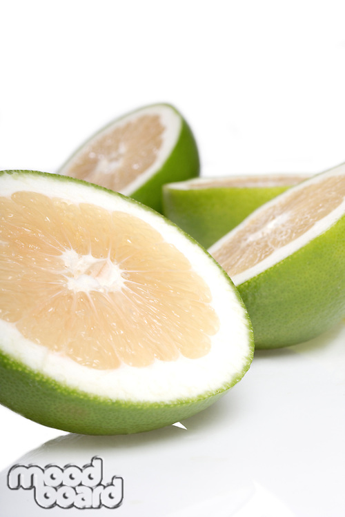 Green grapefruits on white background