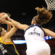 Jordan Hooper, (left), Tulsa Shock, shoots past Kayla Pedersen, Connecticut Sun, during the Connecticut Sun Vs Tulsa Shock WNBA regular season game at Mohegan Sun Arena, Uncasville, Connecticut, USA. 3rd July 2014. Photo Tim Clayton