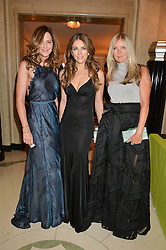 Left to right, TRINNY WOODALL, ELIZABETH HURLEY and AMANDA WAKELEY at the QBF Spring Gala in aid of the Red Cross War Memorial Children's Hospital hosted by Heather Kerzner and Jeanette Calliva at Claridge's, Brook Street, London on 12th May 2015.