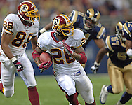 Washington Redskins running back Clinton Portis (C) rushes through the Rams defenses for a 47-yard touchdown run, giving Washington a 7-0 lead in the first quarter, during the Redskins 24-9 win at the Edward Jones Dome in St. Louis, Missouri, December 4, 2005.