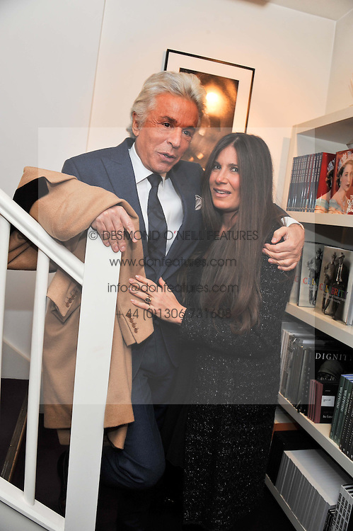 GIANCARLO GIAMMETTI and ELIZABETH SALTZMAN at a private view of photographs by Anthony Souza held at The Little Black Gallery, 13A Park Walk, London SW10 on 13th December 2011.
