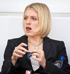 LONDON, ENGLAND - Saturday, September 19, 2009: ESPN's touchline reporter Rebecca Lowe eats chocolate before the West Ham United versus Liverpool Premiership match at Upton Park. (Pic by David Rawcliffe/Propaganda)
