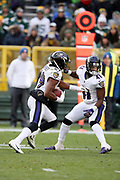 Baltimore Ravens cornerback Anthony Levine Sr. (41) looks to block for Baltimore Ravens rookie defensive back Marlon Humphrey (29) after Humphrey intercepts a fourth quarter pass and runs it back to the Green Bay Packers 3 yard line clinching the Ravens win during the 2017 NFL week 11 regular season football game against the against the Green Bay Packers, Sunday, Nov. 19, 2017 in Green Bay, Wis. The Ravens won the game in a 23-0 shutout. (©Paul Anthony Spinelli)