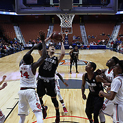 Michael Carrera, South Carolina, drives to the basket  past Kassoum Yakwe, St. John's, during the St. John's vs South Carolina Men's College Basketball game in the Hall of Fame Shootout Tournament at Mohegan Sun Arena, Uncasville, Connecticut, USA. 22nd December 2015. Photo Tim Clayton