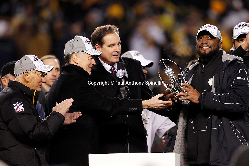 Pittsburgh Steelers head coach Mike Tomlin smiles as he is presented with the AFC Champion Lamar Hunt Trophy during the postgame trophy presentation after winning the NFL 2011 AFC Championship playoff football game against the New York Jets on Sunday, January 23, 2011 in Pittsburgh, Pennsylvania. The Steelers won the game 24-19. (©Paul Anthony Spinelli)