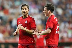 04.08.2015, Allianz Arena, Muenchen, GER, AUDI CUP, FC Bayern Muenchen vs AC Mailand, im Bild Pierre-Emile Hoejbjerg (FC Bayern Muenchen #34) im Gespraech mit Xabi Alonso (FC Bayern Muenchen #3) // during the 2015 AUDI Cup Match between FC Bayern Muenchen and AC Mailand at the Allianz Arena in Muenchen, Germany on 2015/08/04. EXPA Pictures © 2015, PhotoCredit: EXPA/ Eibner-Pressefoto/ Schüler<br /> <br /> *****ATTENTION - OUT of GER*****