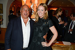 SIR PHILIP GREEN and Editor of Tatler KATE REARDON at an exhibition of the 50 best party pictures from Tatler from the past 50 years, held at Annabel's, Berkeley Square, London on 9th September 2013.