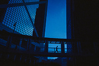 A man crosses an elevated walkway in the business district of Hong Kong.