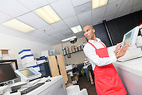 African American man working at printing press