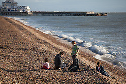 © Licensed to London News Pictures. 24/12/2014. Southsea, Hampshire, UK. A family on the beach enjoying the sunny weather today, Christmas Eve, in Southsea, Hampshire. Photo credit : Rob Arnold/LNP