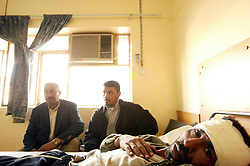 Jabar Saber, 29, is seen resting in the local hospital in Iskandariyah, Iraq, Feb. 10, 2004.<br />