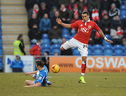 Bristol City's James Tavernier is tackled by Colchester United's Tom Lapslie - Photo mandatory by-line: Dougie Allward/JMP - Mobile: 07966 386802 - 21/02/2015 - SPORT - Football - Colchester - Colchester Community Stadium - Colchester United v Bristol City - Sky Bet League One
