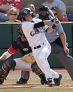 Kansas State's Tyler Link drives the ball to left field of Husker pitcher tony Watson.  Nebraska held on to beat Kansas State 5-4 at Tointon Stadium in Manhattan, Kansas, April 1, 2006.