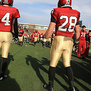 Harvard players warming up on the sideline during the Harvard Vs Yale, College Football, Ivy League deciding game, Harvard Stadium, Boston, Massachusetts, USA. 22nd November 2014. Photo Tim Clayton