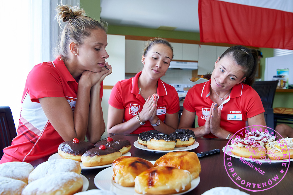 KAILUA KONA, USA - 2016 FEBRUARY 04: (L-R) Magda Linette and Paula Kania and Alicja Rosolska all from Poland taste sweets &quot;Tlusty Czwarek&quot; on two days before the Fed Cup World Group II 1st round tennis match between USA and Poland on February 04, 2016 at Holua Tennis Center in Kailua Kona, USA.<br /> <br /> Picture also available in RAW (NEF) or TIFF format on special request.<br /> <br /> Any editorial, commercial or promotional use requires written permission from the author of image.<br /> <br /> Adam Nurkiewicz declares that he has no rights to the image of people at the photographs of his authorship.<br /> <br /> Mandatory credit:<br /> Photo by &copy; Adam Nurkiewicz / Mediasport