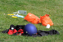 ©  licensed to London News Pictures .26/04/2011.  Detling, UK . A helmet and medical equipment lying on the ground at the scene where a man died performing a human cannonball stunt. Spectators watched the safety net fail on The Human Cannon at  Scott May's Daredevil Stunt Show at Kent County Show Ground. See special instructions. Picture credit should read Grant Falvey/LNP.