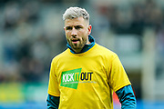 Paul Dummett (#3) of Newcastle United wearing a 'Kick It Out' campaign t-shirt during the warm-up ahead of the Premier League match between Newcastle United and Crystal Palace at St. James's Park, Newcastle, England on 6 April 2019.