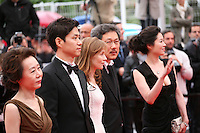 Yu Junsang, Moon Sori,  Isabelle Huppert, Hong Sangsoo, Youn Yuh-jung arriving at the DA-REUN NA-RA-E-SUH (IN ANOTHER COUNTRY)  gala screening at the 65th Cannes Film Festival France. Monday 21st May 2012 in Cannes Film Festival, France.