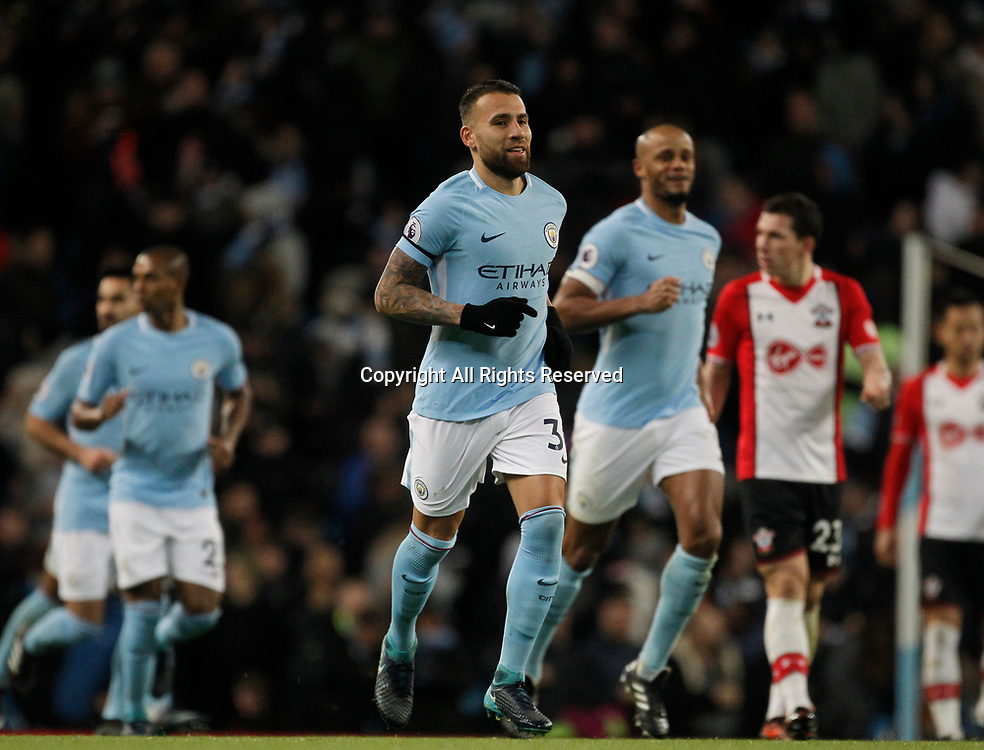 29th November 2017, Etihad Stadium, Manchester, England; EPL Premier League football, Manchester City versus Southampton; Nicolas Otamendi of Manchester City celebrates after initially being credited with City's first goal after 47 minutes