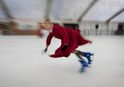 © Licensed to London News Pictures. 18/11/2016. Winchester, UK. A chorister from Winchester Cathedral takes a tumble  as he tries out the seasonal ice rink. Celebrating it's 10th anniversary, the ice rink opens to the public from today until January 2, 2017. Photo credit: Peter Macdiarmid/LNP
