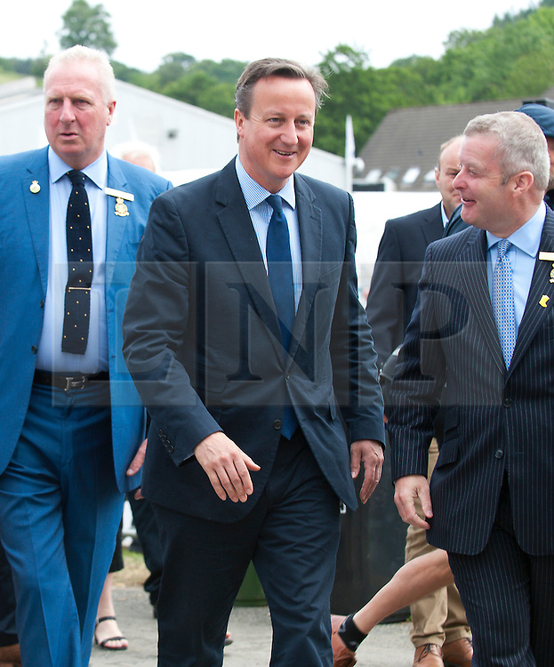 © Licensed to London News Pictures. 23/07/2015. Llanelwedd, Powys, UK.  David Cameron, Prime Minister of the UK, visits the Royal Welsh Show. The Royal Welsh Agricultural Show is hailed as the largest & most prestigious event of it's kind in Europe. In excess of 200,000 visitors are expected this week over the four day show period - 2014 saw 237,694 visitors, 1,033 trade stands & a record 7,959 livestock exhibitors. The first ever show was at Aberystwyth in 1904 and attracted 442 livestock entries. Photo credit: Graham M. Lawrence/LNP