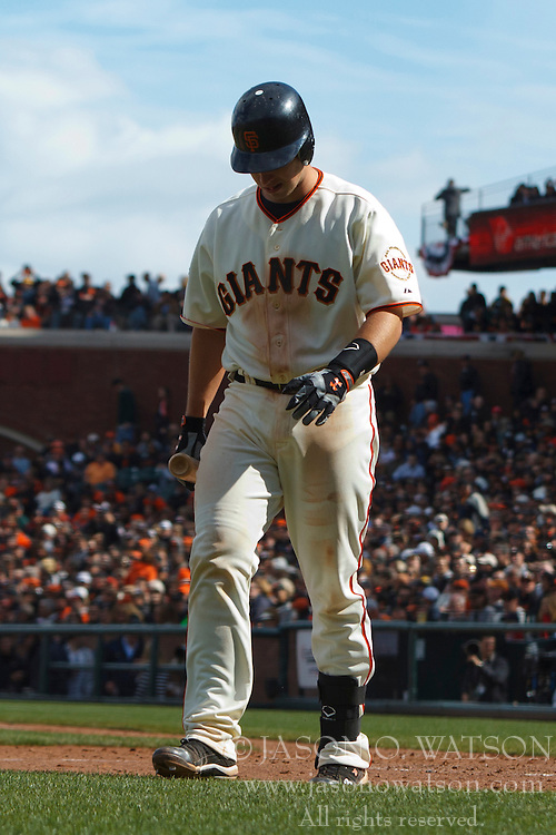April 8, 2011; San Francisco, CA, USA;  San Francisco Giants catcher Buster Posey (28) returns to the dugout after striking out against the St. Louis Cardinals during the seventh inning at AT&T Park.  San Francisco defeated St. Louis 5-4 in 12 innings.