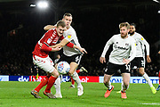 George Saville (22) of Middlesbrough battles for possession with Kevin McDonald (6) of Fulham during the EFL Sky Bet Championship match between Fulham and Middlesbrough at Craven Cottage, London, England on 17 January 2020.