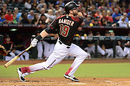 PHOENIX, AZ - SEPTEMBER 17:  Mitch Haniger #19 of the Arizona Diamondbacks watches the ball in flight in the second inning against the Los Angeles Dodgers at Chase Field on September 17, 2016 in Phoenix, Arizona. The Dodgers won 6 - 2.  (Photo by Jennifer Stewart/Getty Images)