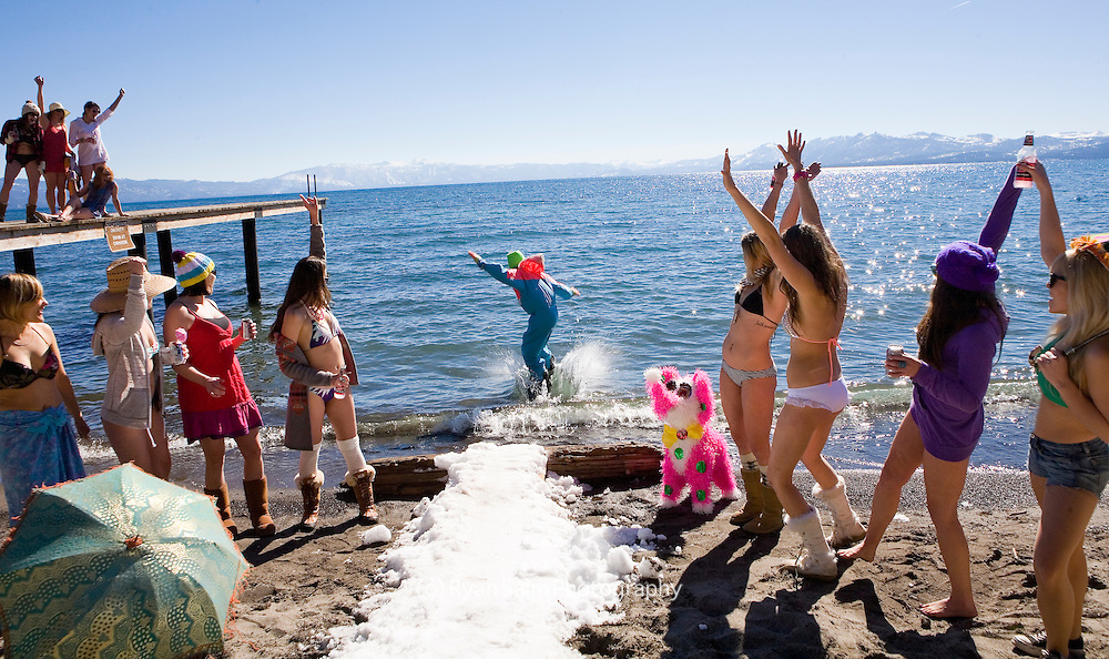 Dane Shannon shows his Tahoe antics as he snowboards into Lake Tahoe surrounded by bikini clad babes.