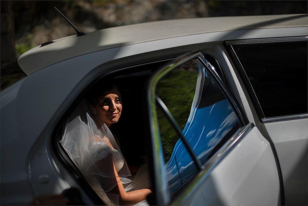 A bride steps out of a limousine prior to her ceremony held in North Jersey.