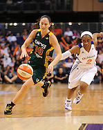 Sep 17, 2011; Phoenix, AZ, USA; Seattle Storm guard Sue Bird (10) handles the ball against Phoenix Mercury guard  Temeka Johnson (2) during the second half at the US Airways Center.  The Mercury defeated the Storm 92 - 83. Mandatory Credit: Jennifer Stewart-US PRESSWIRE