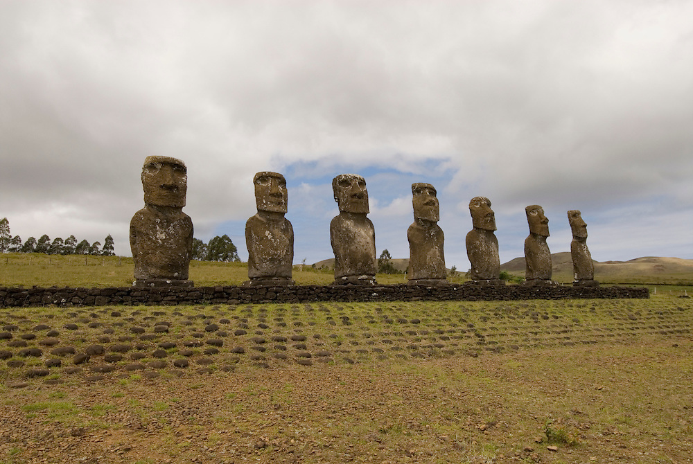 Chile, Easter Island: Statues or moai on a platform or ahu at Ahu Akivi, an inland array of moai, unusual because most moai face inland from the edge of the sea..Photo #: ch299-33631..Photo copyright Lee Foster www.fostertravel.com lee@fostertravel.com 510-549-2202