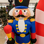 Plastic blow up Nutcracker Soldier indoor Christmas  holiday decoration in PATH Journal Square Station.