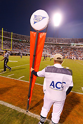 Oct 22, 2011; Charlottesville VA, USA;  An ACC linesman with a distance marker on the sidelines during the fourth quarter between the Virginia Cavaliers and the North Carolina State Wolfpack at Scott Stadium.  North Carolina State defeated Virginia 28-14. Mandatory Credit: Jason O. Watson-US PRESSWIRE