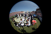 The Los Angeles Rams take a break on the sideline in this wide angle general view photograph taken of the bench area during the 2018 NFL preseason week 3 football game against the Houston Texans on Saturday, Aug. 25, 2018 in Los Angeles. The Rams won the game 21-20. (©Paul Anthony Spinelli)