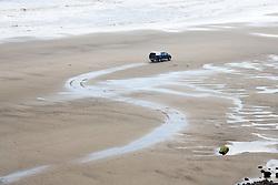 Car on beach at Mappleton; East Yorkshire; England