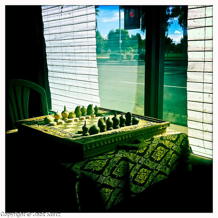 13 NOVEMBER 2011 - PHOENIX, AZ: A chess set near a window in a Cambodian restaurant on Indian School Rd in Phoenix, AZ.  PHOTO BY JACK KURTZ
