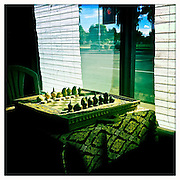 13 NOVEMBER 2011 - PHOENIX, AZ: A chess set near a window in a Cambodian restaurant on Indian School Rd in Phoenix, AZ.  PHOTO BY JACK KURTZ