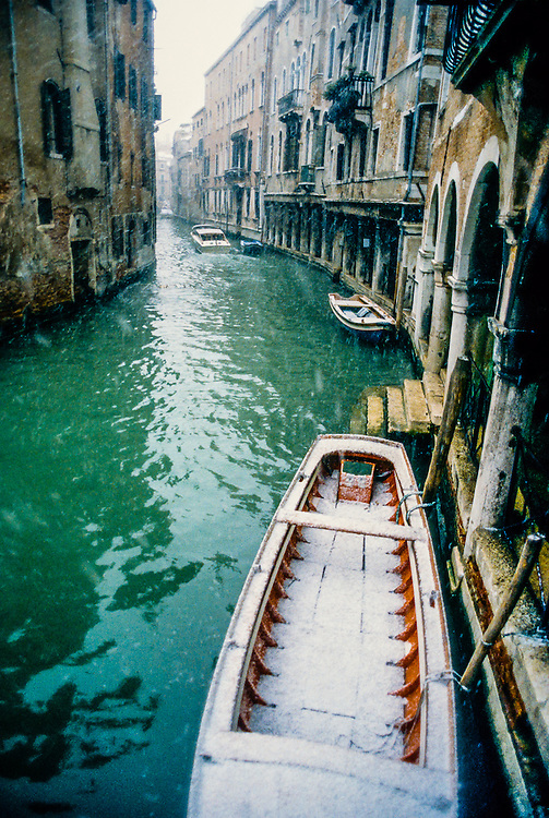 A snowy winter day along the back canals of Venice, Italy.