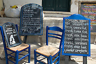 Chalk board menus in Greek and English at a taverna in Asos, Kefalonia, the Ionian Islands, Greece
