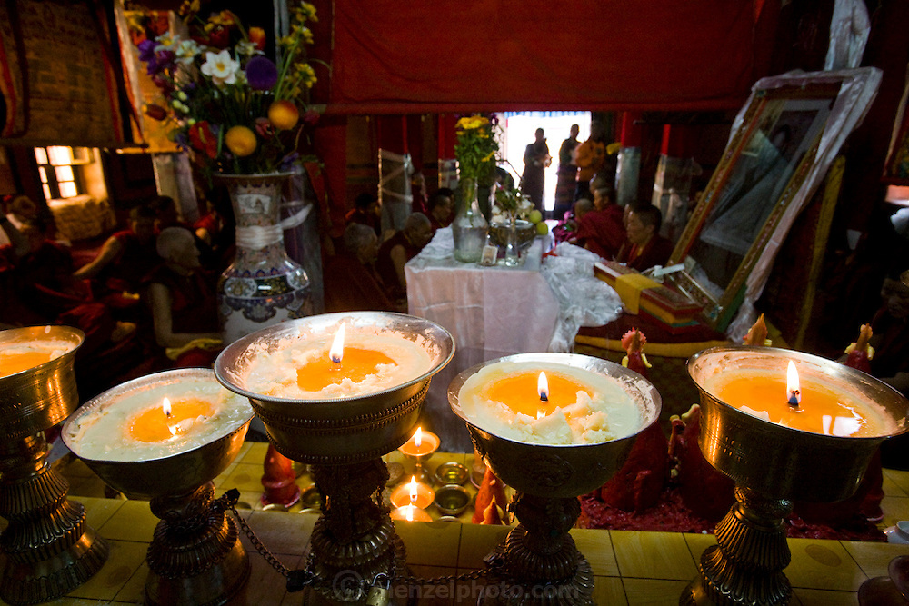 Candles illuminate part of the Lhasaani Tsang Kung Nunnery in Lhasa, Tibet.