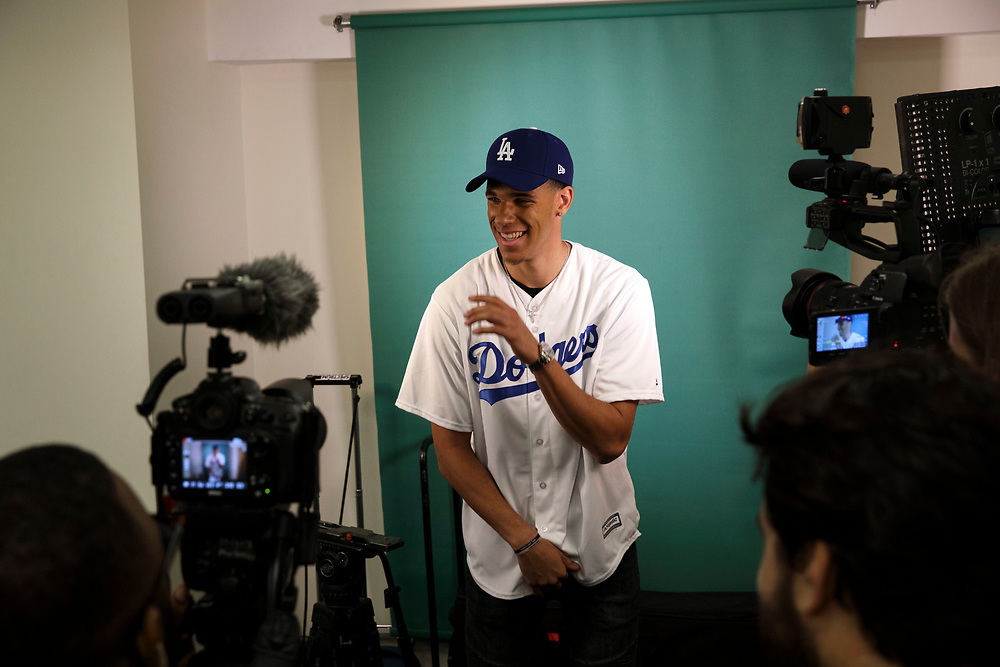 Lakers draft pick Lonzo Ball laughs as he records a video on a green screen after throwing out the first pitch at Dodger Stadium on Friday, June 23, 2017 in El Segundo, California. The Lakers selected Lonzo Ball as the No. 2 overall NBA draft pick and is the son of LaVar Ball. © 2017 Patrick T. Fallon