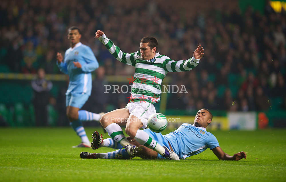 GLASGOW, SCOTLAND - Monday, November 7, 2011: Glasgow Celtic's Tony Watt is tackled by Manchester City's Courtney Meppen-Walters during the NextGen Series Group 1 match at Celtic Park. (Pic by David Rawcliffe/Propaganda)
