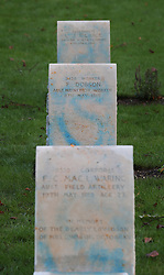 © Licensed to London News Pictures. 23/11/2015. London, UK. Blue spray paint is seen on vandalised war graves at The Australian Military Cemetery next to St Mary's Parish Church in Harefield.  Photo credit: Peter Macdiarmid/LNP
