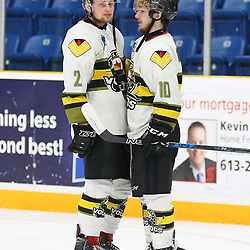 TRENTON, ON  - MAY 5,  2017: Canadian Junior Hockey League, Central Canadian Jr. &quot;A&quot; Championship. The Dudley Hewitt Cup Game 7 between Georgetown Raiders and the Powassan Voodoos.    Justin Schebel #2 and  Tyler Gervais-Rolfe #10 of the Powassan Voodoos talk before leaving the ice for the final time post game.<br /> (Photo by Alex D'Addese / OJHL Images)