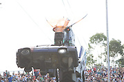 The Easter Show, Sydney-AustraliaThe Easter Show, Sydney-Australia.A Robosaurus standing 12 metres tall lifts a car and roasts it with a jet of flaming breath and thenrips it to pieces with its crushing claws and stainless steel teeth..Paul Lovelace Photography . An instant sale option is available where a price can be agreed on image useage size. Please contact me if this option is preferred.